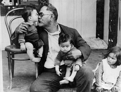 Māori grandfather with grandchildren