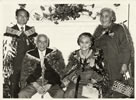 Carver Wiremu Te Ranga (Piri) Poutapu (seated, left) after receiving the MBE honour in 1974
