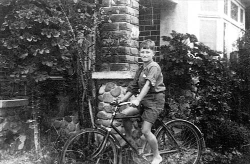 Young Alan on a bicycle