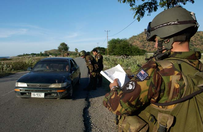 New Zealand military personnel at a checkpoint, Dili, East Timor, 2006