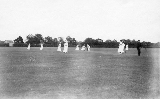 Women playing cricket