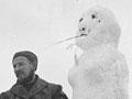 Coast-watchers with snowwoman, Auckland Islands, 1942