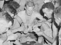 Playing cards on a troopship, 1943