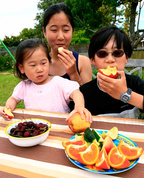 Children eating fruit, 2007