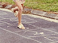 Girls playing hopscotch, around 1970