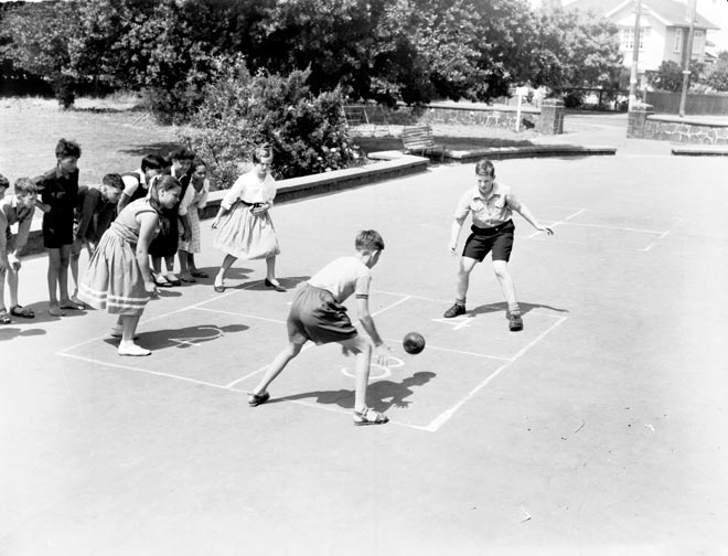 Children playing four square, 1959