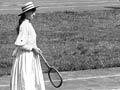 Girls playing tennis, 1889