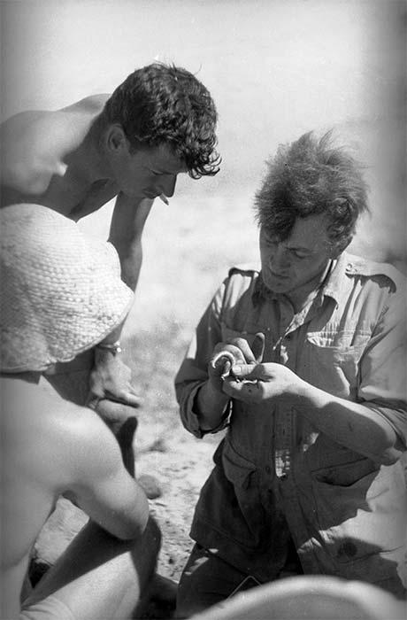 Jack Golson examining a fish hook
