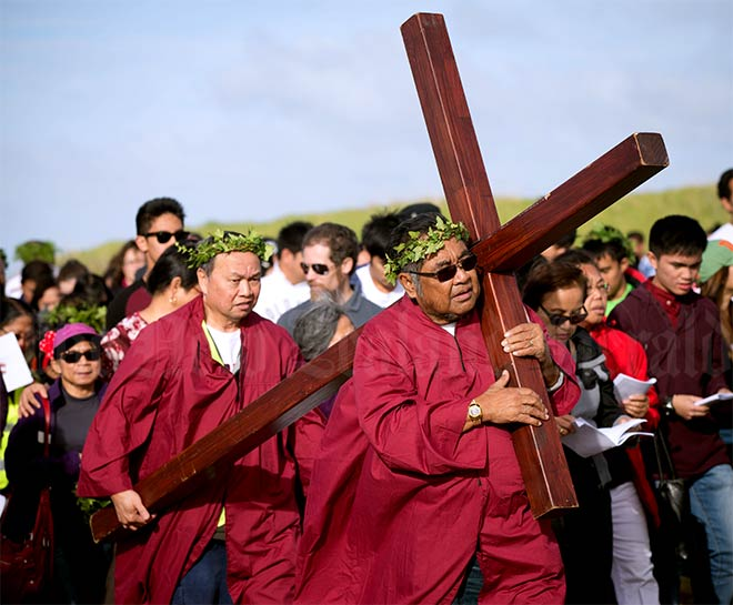 Religious observance: Carrying the cross
