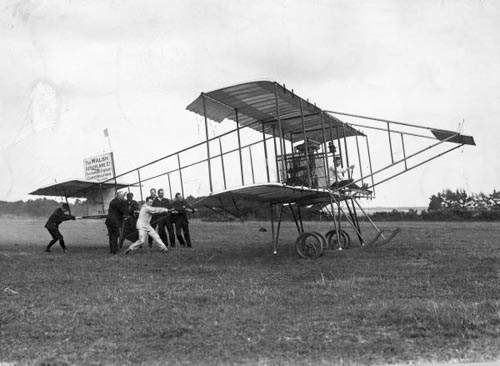 The biplane Manurewa making a flight from Glenora Park, Papakura, Auckland, probably in 1911