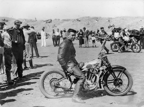 Percy Coleman on a Royal Enfield motorcycle, Waikanae Beach, about 1930