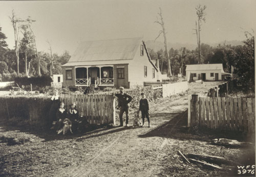 Christian Hansen (second from right) outside the accommodation house at Motu, early twentieth century