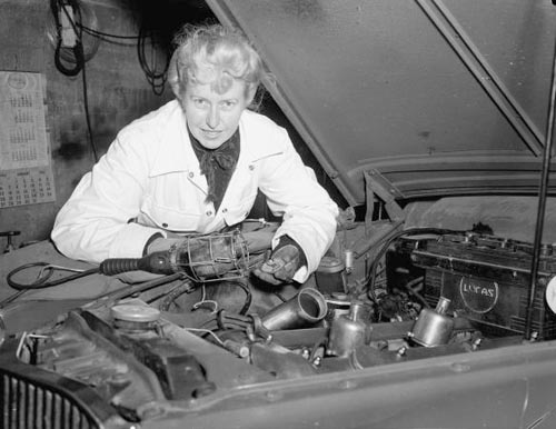 Sybil Audrey Marie Lupp working on a Jaguar at her Wellington garage