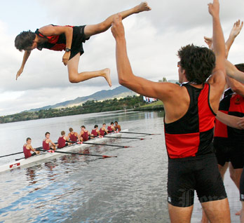 Hamilton Boys' High School rowers throw their cox into Lake Karapiro after winning the Maadi Cup