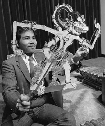 Mr Widiyanto holds a Javanese shadow puppet