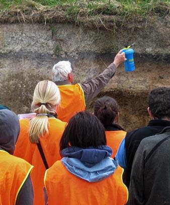 Students examine a soil profile