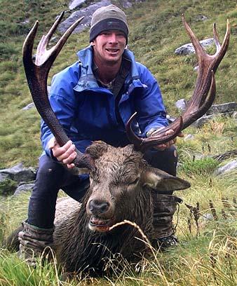 Hunter with a wapiti–red deer