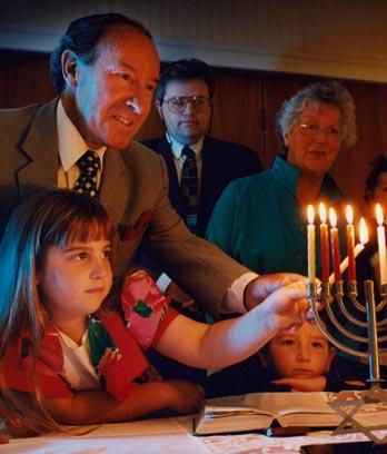 A Jewish family celebrate Hanukkah