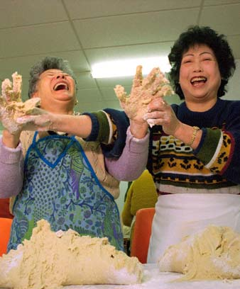 Women making red bean dumplings for a Chinese bazaar, 1995