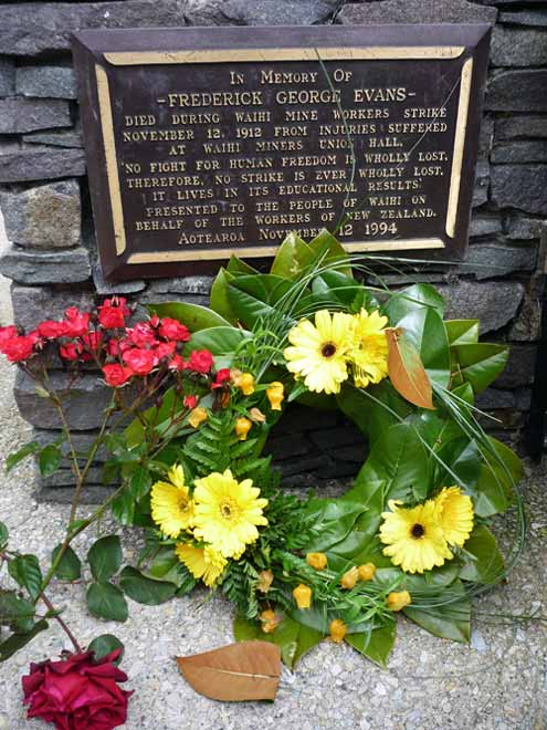 Flowers adorn the plaque to the memory of Fred Eva...