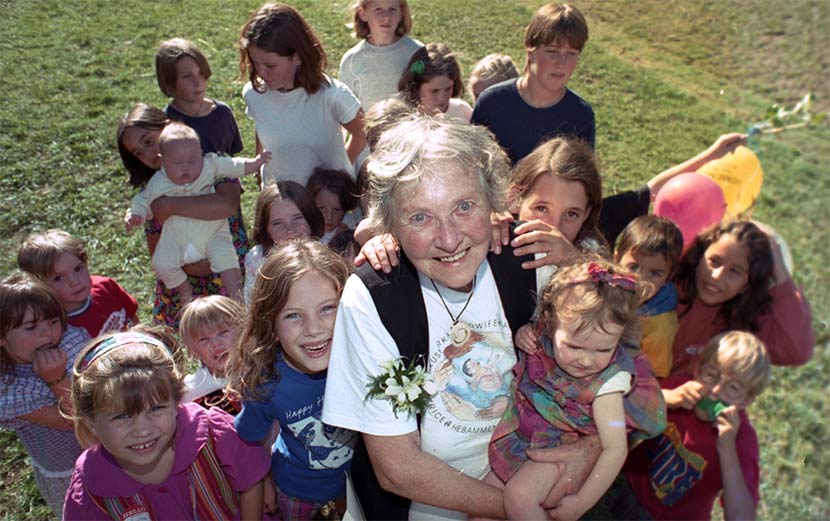 Joan Donley and some of the children she 'caught'