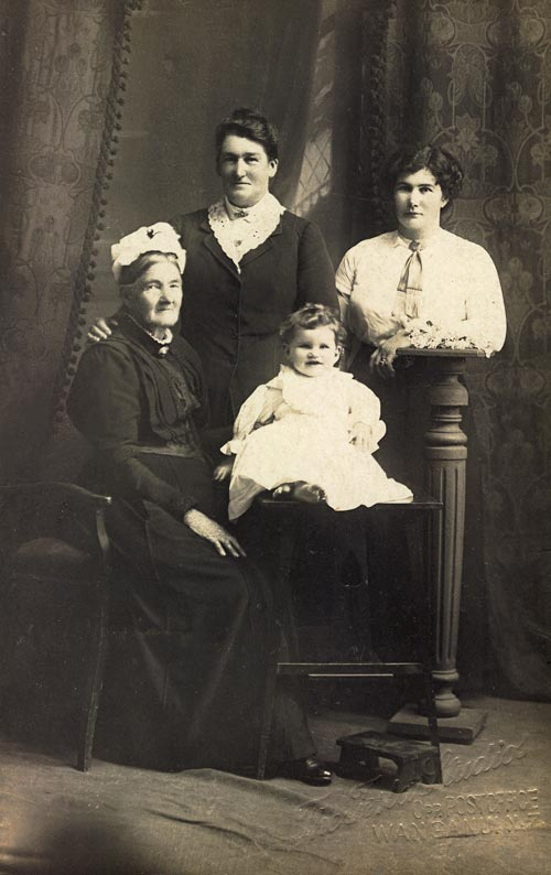 Fanny McHugh (standing, centre) with her daughter Gladys (right), mother Margaret (left) and baby granddaughter Frances