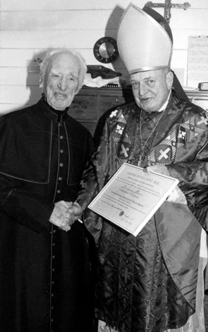 Nicholas Moore (left) and Bishop O. N. Snedden