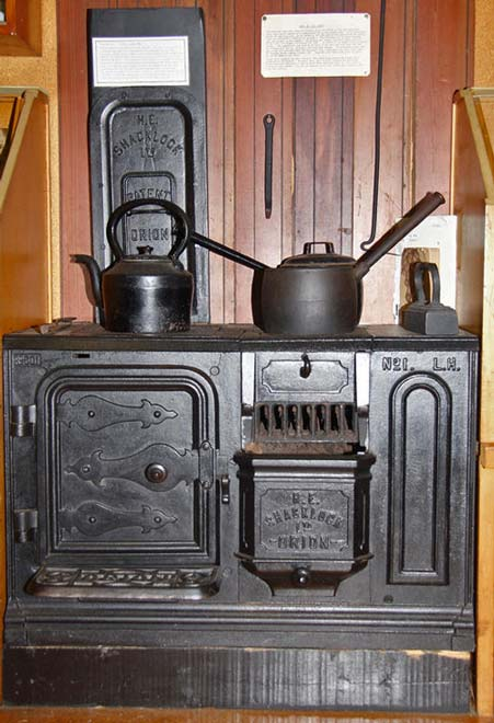 The cast-iron Orion coal- or wood-burning stove, d...