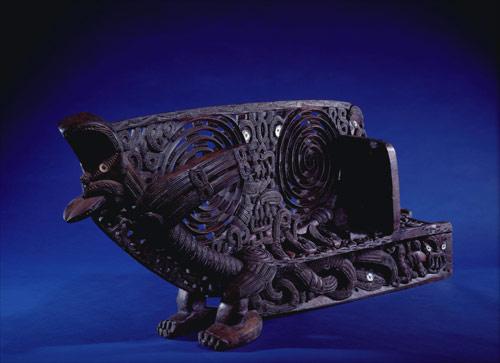 Waka taua carvings