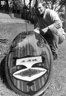 Nigel Dwyer with a Del surfboard