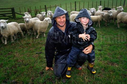 Farmer dad and son