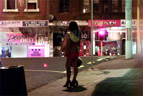 A sex worker on Karangahape Road, Auckland. In 2003 Parliament passed, ...