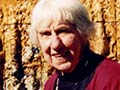 Doreen Blumhardt with Christian Science church wall